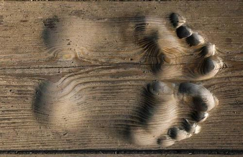A Buddhist monk's footprints are permanently etched into the floorboards he has been praying on every day for 20 years.