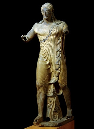 Apollo from Veii! Terracota. Originally a rooftop decoration on a temple, that is why his features are so exaggerated. Archaic style.