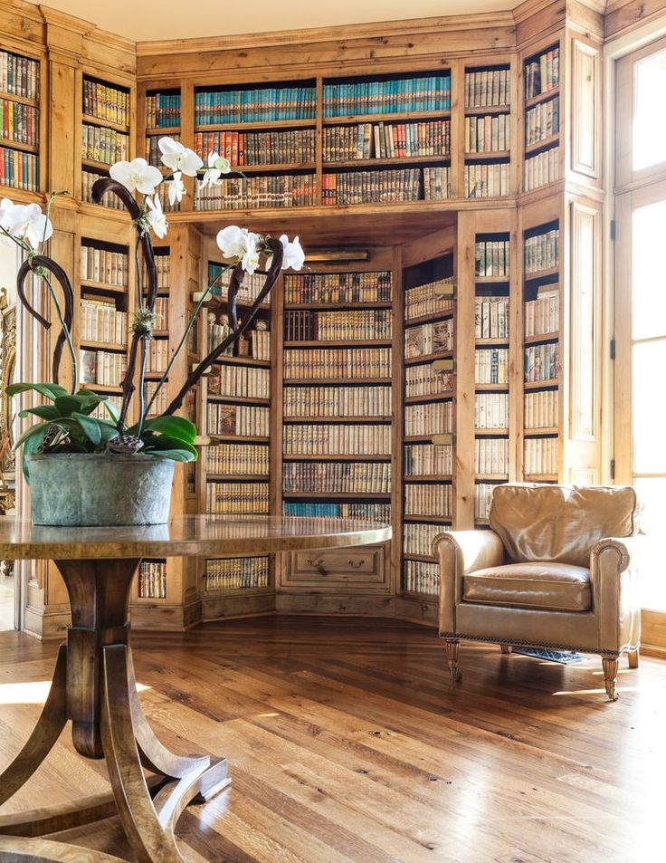 book lovers family room mediterranean with natural light contemporary artificial flowers