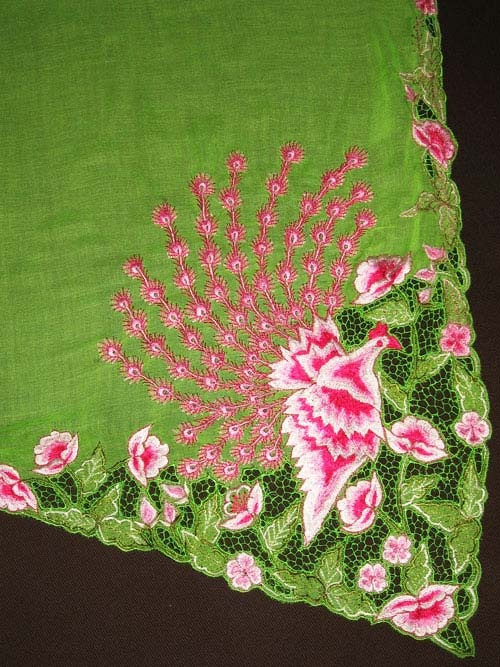 Peranakan peacock sulam(embroidery) found along hemline of kebaya top.