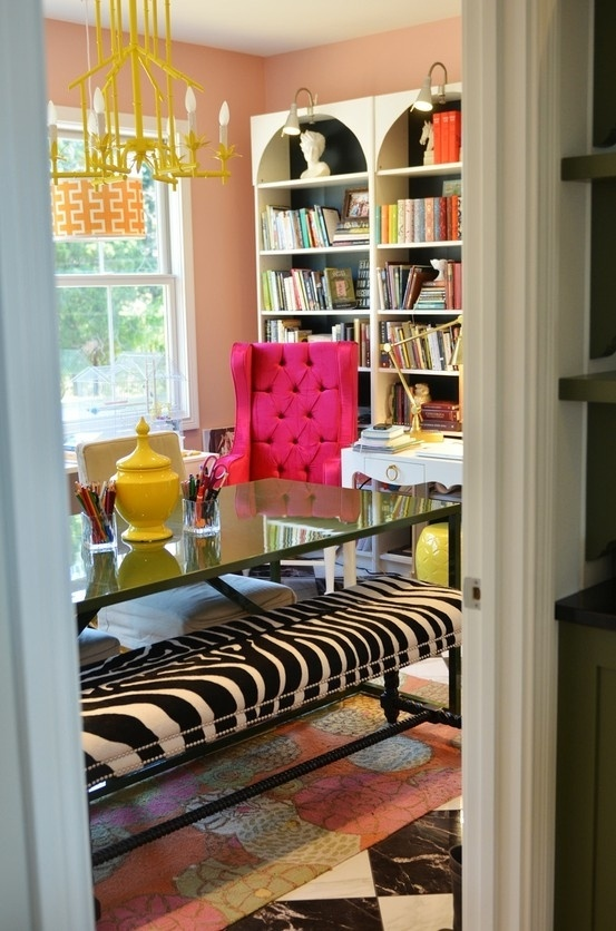 Hot pink tufted chair, zebra bench, yellow accents, white shelves with the inside painted. Girly and fun.
