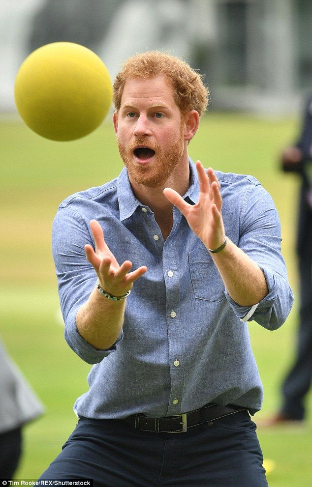 An animated Prince Harry concentrates as he prepares to catch a ball at Lord's