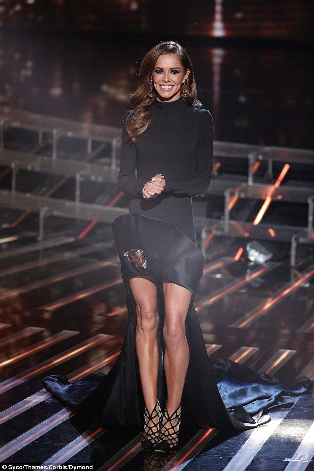 Them legs! Cheryl went for a black look as she slipped into a fabulous creation for the live semi-final, where she looked gothic and dramatic in a mullet-hemmed gown which showed off her sensational pins