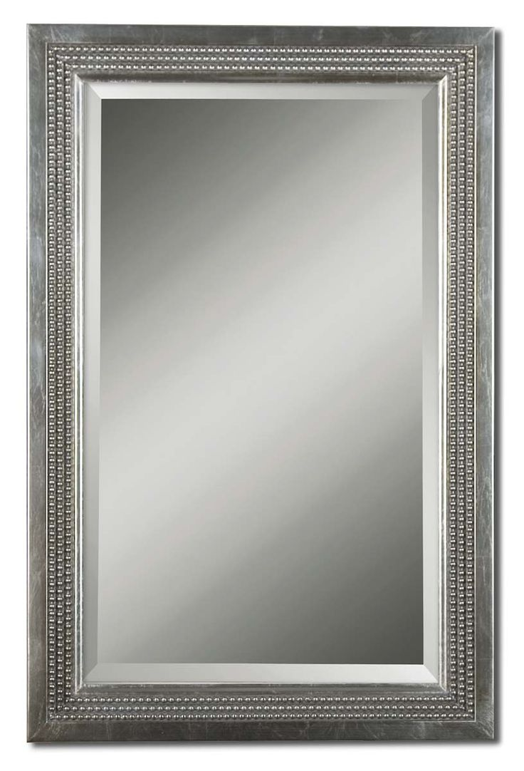 The classy frame features a silver leaf finish with a light gray glaze. The mirror is beveled and may be hung either horizontally or vertically.