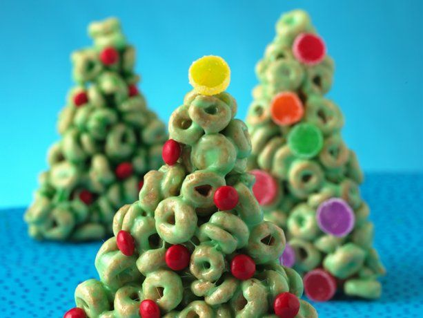 Cheerios Christmas Trees: 6 C Honey Nut Cheerios; 6 T butter or oleo; 4-1/2 C miniature marshmallows; green food color and red cinnamon candies and/or sliced gumdrops. Line a cookie sheet with waxed paper. Pour cereal into a 4-qt bowl. Set the bowl aside. Place butter & marshmallows in a 3-qt saucepan. Heat over low heat, stirring constantly, until the mixture is smooth. Remove the pan from heat.