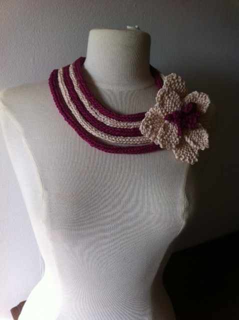 hand knitted cords with hand knitted corsage in cotton by Ann Gleeson Knitwear