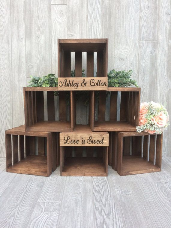 Love is sweet with this personalized wooden crate cupcake stand. The versatile display is perfect for every rustic wedding ~ showcase cupcakes, favors, and more. Crate display is handcrafted of genuine pine wood and customized to match your event theme. Our unique personalization process creates a subtle rustic look to the font/design. Display holds approximately 120 cupcakes. Have more cupcakes ?? Group the extras around the display directly on the table to create a beautiful and sweet ...