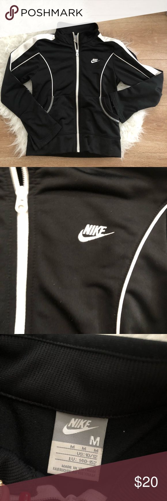 Nike sports jacket Super cute and trendy Nike sports jacket perfect for working out for just for throwing over a simple outfit for instant athlesure style!   This is a youth size medium so it best fits woman's xxs-xs  Mild piling on the back but other than that no flaws! Nike Jackets & Coats