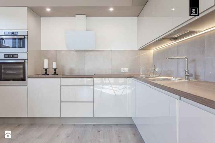 Nowe Kowale - Duża otwarta kuchnia w kształcie litery l, styl nowoczesny - zdjęcie od PRACOWNIE WNĘTRZ KODO