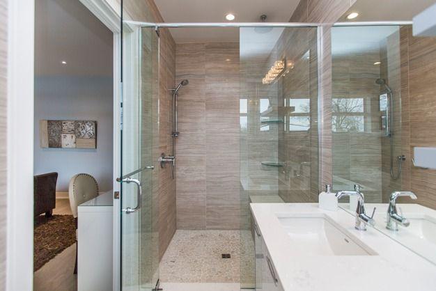 Spacious walk-in shower, seen here in Antilia Homes' 235 Carleton Avenue Property.