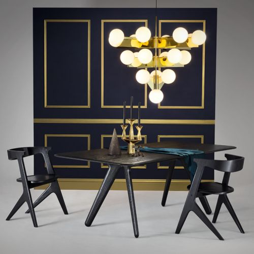http://www.thelollipopshoppe.co.uk/products/lighting/pendant/tom-dixon-plane-chandelier