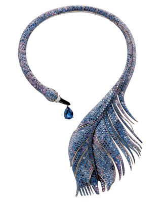 Boucheron: A swan neck-ring made of blackened gold, a pear-shaped sapphire (approximately 16 ct), blue and violet sapphires and a beak of onyx – from the Trouble Désir collection.