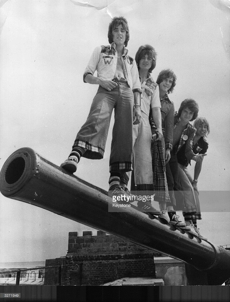 Top Scottish popsters the Bay City Rollers - Woody Wood, Eric Faulkner, Alan Longmuir, Les McKeown and Derek Longmuir - on the barrel of a century-old cannon at Fort St Catherine in Bermuda. The Bay City Rollers, formed in Edinburgh, chose their name by pointing randomly at a map of America and finding Bay City in Michigan. The pop group had their first hit with 'Keep On Dancing' which reached number 9 in the charts in 1971. They rapidly became a teen sensation with dedicated fans who wore…