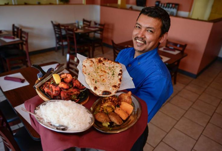 (Francisco Kjolseth | The Salt Lake Tribune)    Bhim Shrestha, owner of Everest Curry Kitchen in Sandy, offers up some of his most popular dishes. Pictured are the Everest Tandoori Mix Grill, a combo of reshami kabab, chicken tikka, lamb chops, shrimp and chicken, chicken wings, garlic naan, and the Everest Platter, a mix of aloo tikki, paneer pakoda, vegetable pakoda and vegetable samosa.