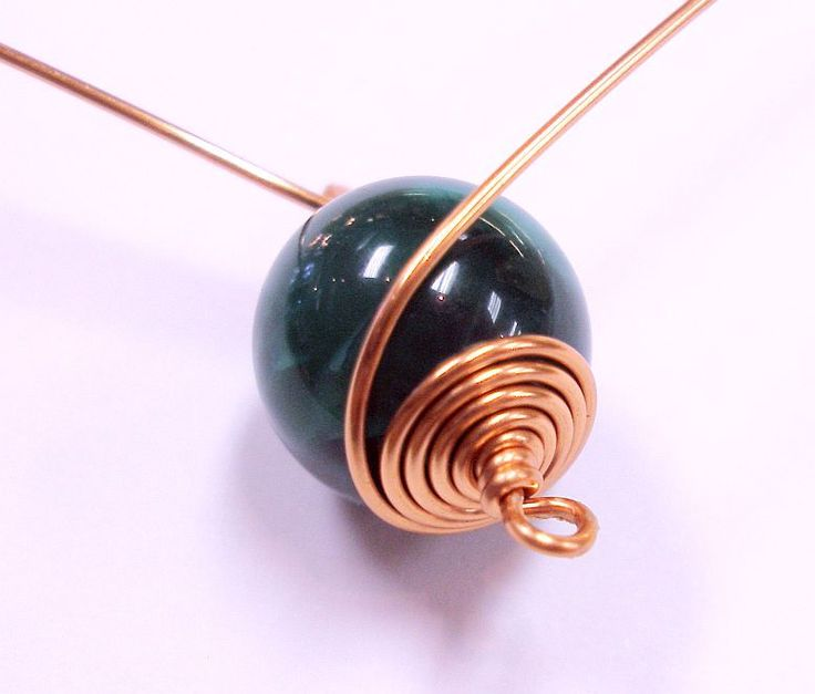 "Here is an easy wire wrapping technique that can be used to dress up almost any kind of bead. It works particularly well on larger round beads. Materials Needed: • (8/10) 10 mm Round Beads • (1) roll 18 ga. Copper Wire • (2"") 16 ga. Copper Wire • (1) 4 mm Copper Jump Ring …"
