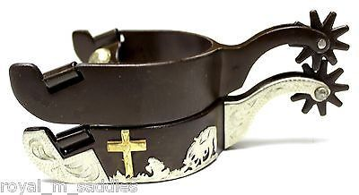 """Western show spurs in antique brown color. Hand engraved silver overlay with cross and praying cowboy with horse. DETAILS- MENS' size, 3 1/4"""" opening, 3 1/4"""" deep Band: 1"""" brown steel Shank: 2 3/4"""" Ro"""