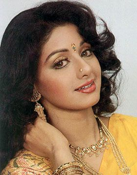Tamil,Telugu and Hindi actress SriDevi in a glamorous shot. In her earlier Tamil films, she was the innocent and simple girl next door. She still looks young and very pretty even after acting in so many films for many years.