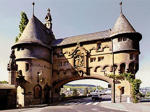 Traben-Trarbach. Art Nouveau buildings characterise the river front of the town, which prospered on the wine trade  at the end of the 19th century. The Trarbach Bridge Gate of 1898, a romantic pastiche of the great age of castle building,  also has elements of Art Nouveau.