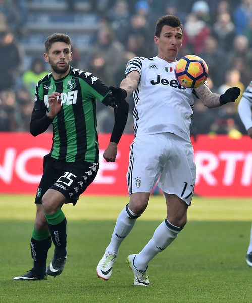 Domenico Berardi of US Sassuolo and Mario Mandzukic of Juventus FC in action during the Serie A match between US Sassuolo and Juventus FC at Mapei Stadium - Citta' del Tricolore on January 29, 2017 in Reggio nell'Emilia, Italy.