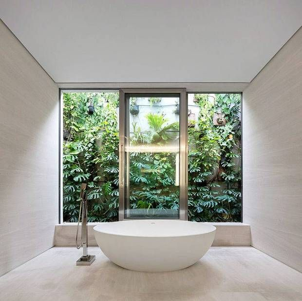 best views white bathroom with view of garden