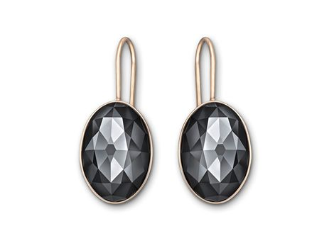 With a smooth, organic silhouette, this pair of pierced earrings is simple yet elegant. Each rose gold-plated earring features a single jet hematite crystal in Swarovski's exclusive cabochon cut. | #thomasjewellers