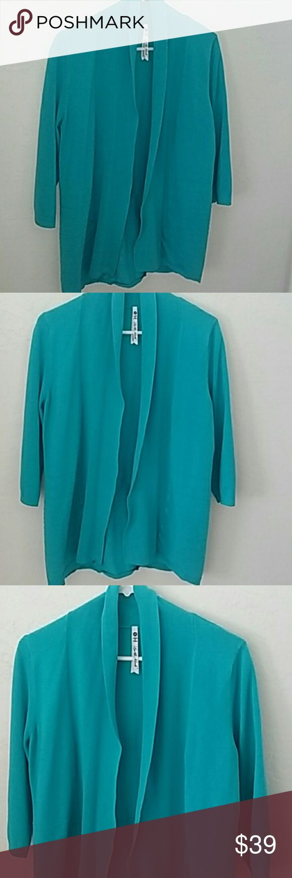 💗CLOSET SALE💗 Turquoise cardigan. .beautiful Cozy turquoise cardigan  Sz M., fits sz L too..very loved condition. .price reflects. Really pretty turquoise color MEASURES APPROX 28 ARMPIT TO ARMPIT X 38  BUNDLE AND SAVE!!! Sweaters Cardigans