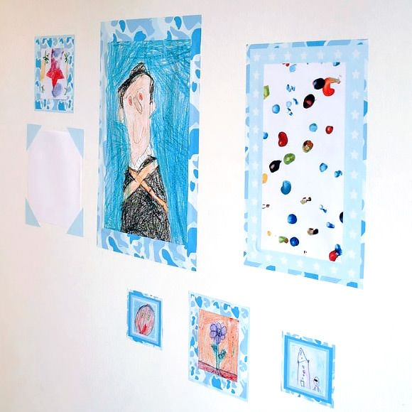 """Laminate pictures and drawings and use arty duct tape and washi tape to """"frame"""""""