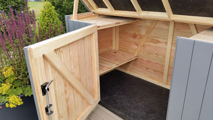Bespoke bike shed with central door and internal shelving, all made from scratch in Bristol.