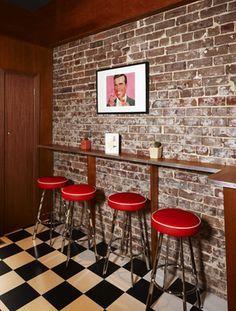 brick wall in bar | This would make a cool bar. Brick wall, red bar stools, checker floor ...