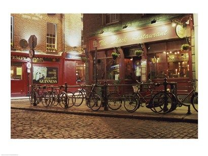 Bicycles parked in front of a restaurant at night, Dublin, Ireland