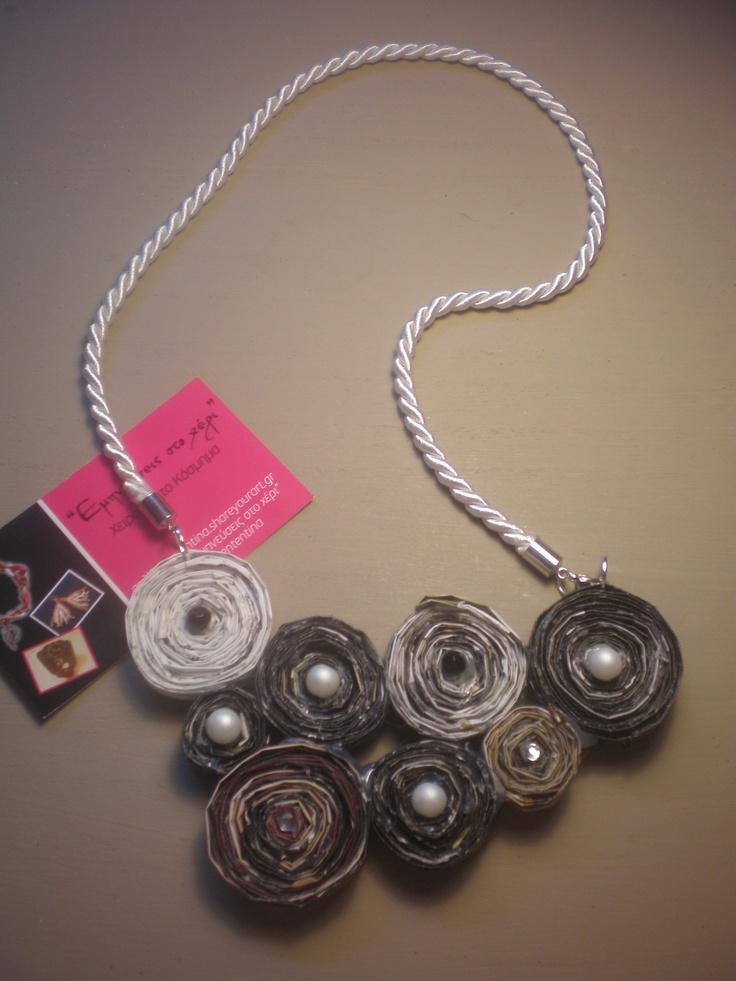 Handmade necklace made ​​from magazine pages and decorated with pearls and Hunt. Working time 5 hours