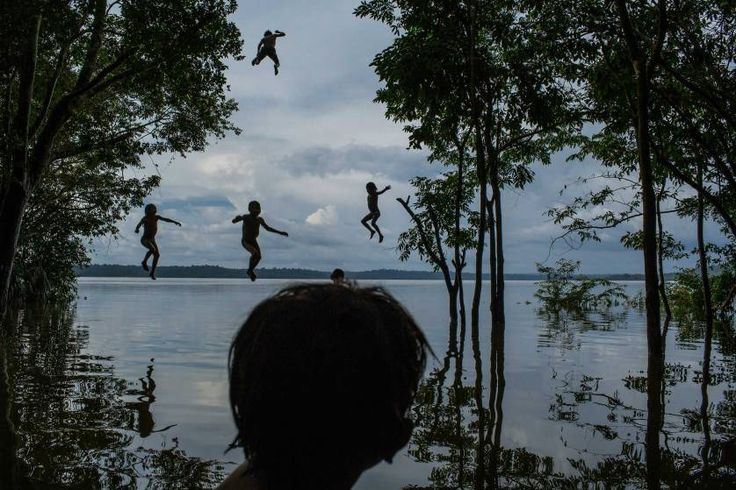 Daily Life, 2nd prize singles. Indigenous Munduruku children play in the Tapajos river in the tribal area of Sawre Muybu, Itaituba, Brazil on Feb. 10, 2015.<br><br>The tribesmen of the Munduruku, who for centuries have sanctified the Tapajos River on which their villages sit, are fighting for survival. Brazil's government plans to flood much of their land to build a $9.9 billion hydroelectric dam, the Sao Luiz do Tapajos, as part of a wider energy strategy across the Amazon rainforest.