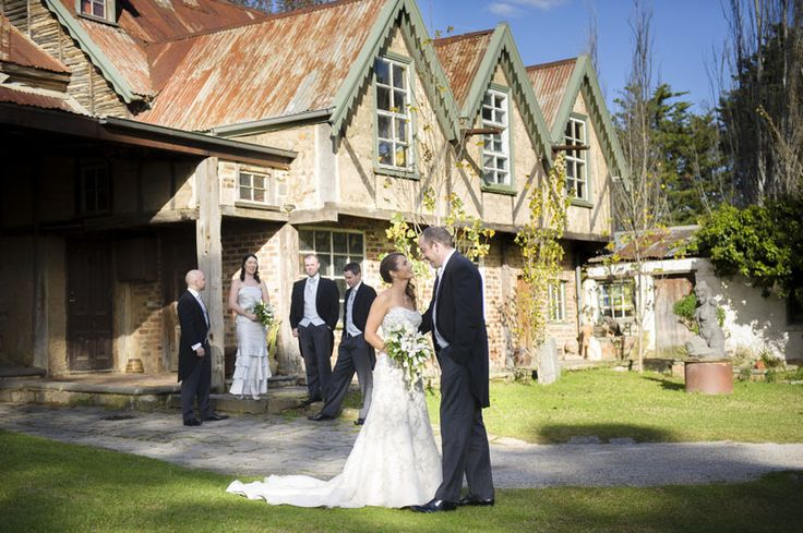Fiona, Michael and their wedding party at Montsalvat. Photographed by Marc Grist Photography #wedding #weddingphotography #weddingparty #groupshot #marcgristphotography.