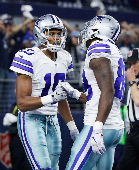 Brice Butler and Dez Bryant of the Dallas Cowboys celebrate after Bryant scored a touchdown in the first half during the NFC Divisional Playoff Game...