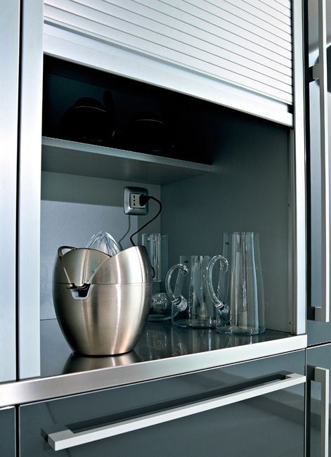 Wow, how clutter-free can you get?!   Aluminum shutter unit with stainless steel worktop, by Pedini.