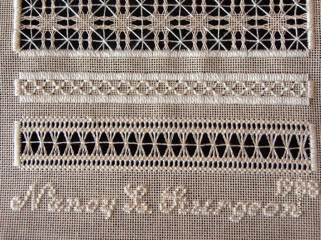 Pulled thread, drawn threadwork, and white work sampler.  Love how she stitched her full signature with half crosses.