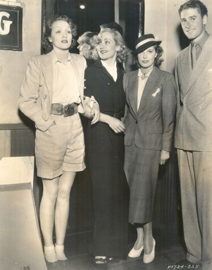 Carole Lombard in the middle with Marlene Dietrich on her right, on her left is Lili Damita with her young husband Errol Flynn.