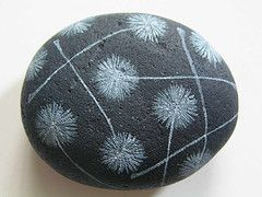 painted stone - white dandelions on black background.  I like that they left it with a mat finish.  natural and zen