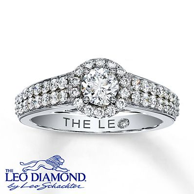 An exceptionally brilliant round Leo Diamond is encircled with more round Leo diamonds in this elegant engagement ring for her. The center diamond is independently certified and laser-inscribed with a unique Gemscribe® serial number, so your diamond will never be mistaken for any other. The 14K white gold band boasts two rows of round Leo diamonds on either side of the center to complete the look. This stunning diamond ring has a total diamond weight of 7/8 carat.