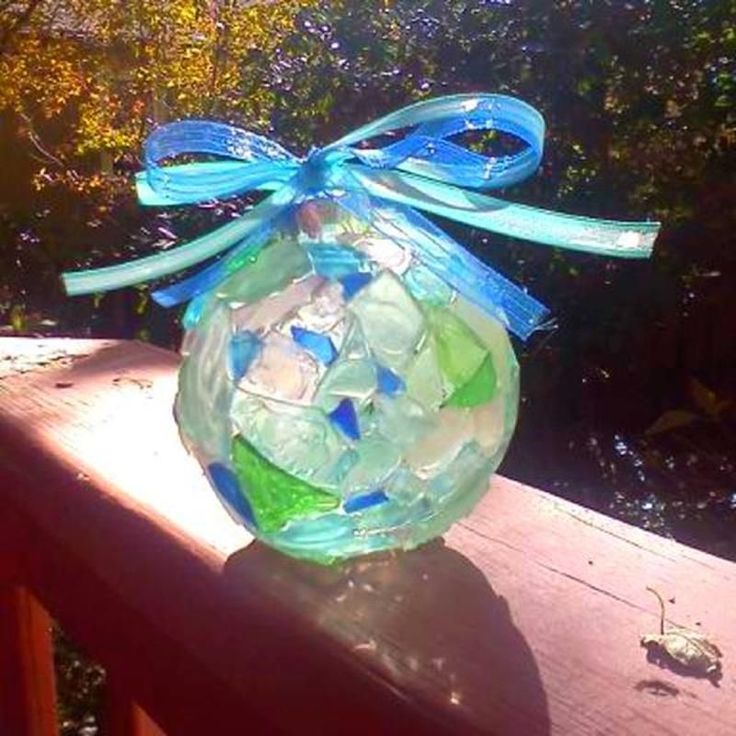 DIY sea glass ornament. I can not find the DIY for this but would like to try a couple for a bowl in my sun room. #diyornaments #seaglassdiy