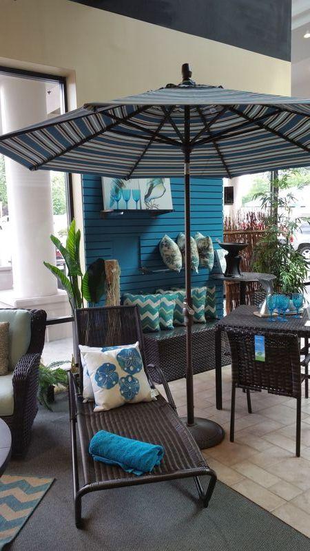 A Patio Umbrella Provides A Bright Splash Of Color And U201cframesu201d The  Furnishings