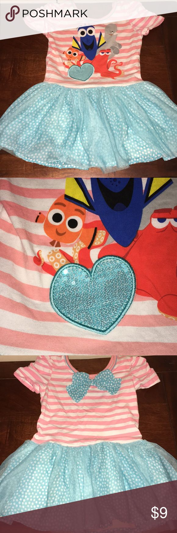 Girls Disney finding dory dress size 5x Pink striped dress on top with blue tutu material with polka dots on bottom  Heart is sequined  Back has a bow on top Sleeves are elastic scrunch Size 5x Disney Dresses Casual