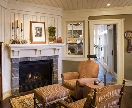stone surround corner fireplace with picture above