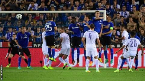 Leicester City celebrated their first ever Champions League match by romping to victory away to Belgium's Club Brugge.  Marc Albrighton scored with the Foxes' first shot after a defensive error from right-back Luis Hernandez's long throw.  Riyad Mahrez curled in a masterful free-kick for 2-0 before half-time.