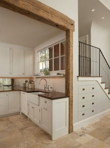 shaker style cabinets.  farmhouse sink.  dark counters.  nice faucet.  subway tile and mirror backsplash.