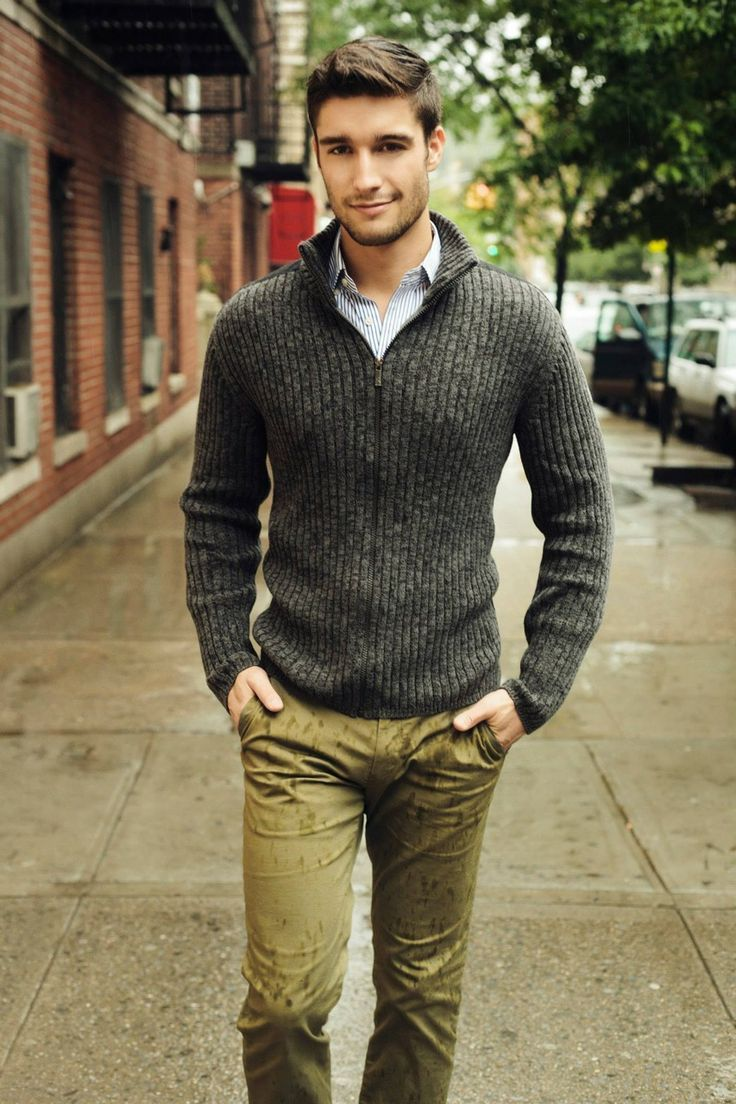 Pair a charcoal cardigan and olive chinos to get a laid-back yet stylish look. Shop this look for $82: http://lookastic.com/men/looks/white-and-navy-vertical-striped-longsleeve-shirt-and-charcoal-cardigan-and-olive-chinos/3802 — White and Navy Vertical Striped Longsleeve Shirt — Charcoal Cardigan — Olive Chinos