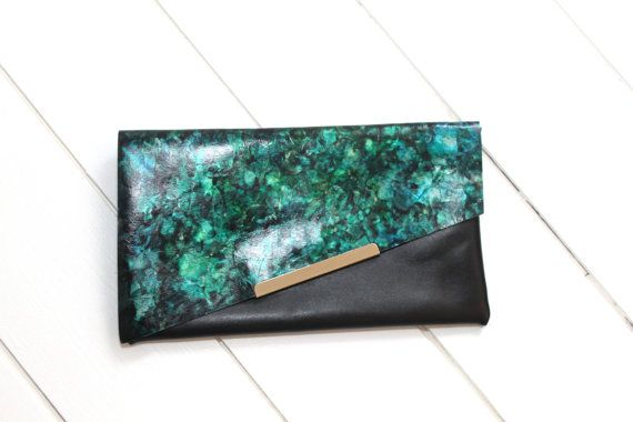 Unique handmade Black Genuine Italian Calf Leather ART Dyed clutch bag in mixed Green, Emerald & Gold tones. Luxury Party Clutch. Designed in our UK Lancashire studio.  Machine stitched (using a vintage Singer hand turned machine), the soft and lightweight calf leather features a unique hand painted ART design in a contemporary abstract theme which will be the only one of its kind.  The finishing touches add more than enough to make the bag stand out from the crowd with a gold tone metal ...