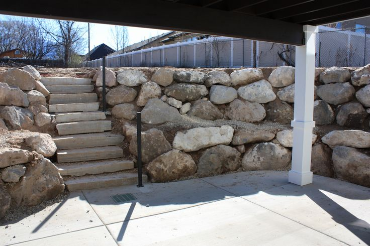 Walk Out Basement Retaining Wall And Stone Steps Cottage Exterior Walkout Basement Patio