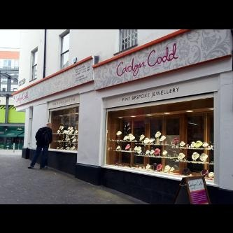 Hand painted shopfront- logos, lettering & corporate pattern