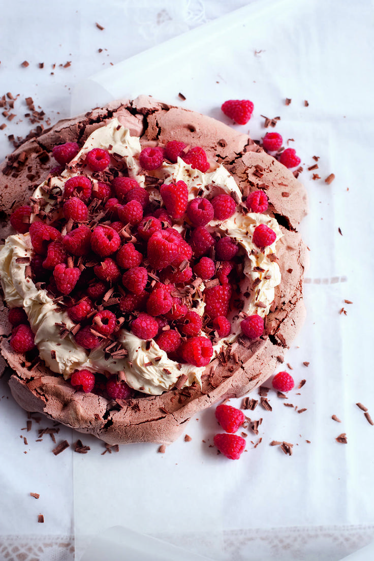 You can't beat a pavlova recipe, especially a crisp-chewy meringue base, with nuggets of chocolate. The meringue provides an enticing layer beneath the cream and crimson raspberries.